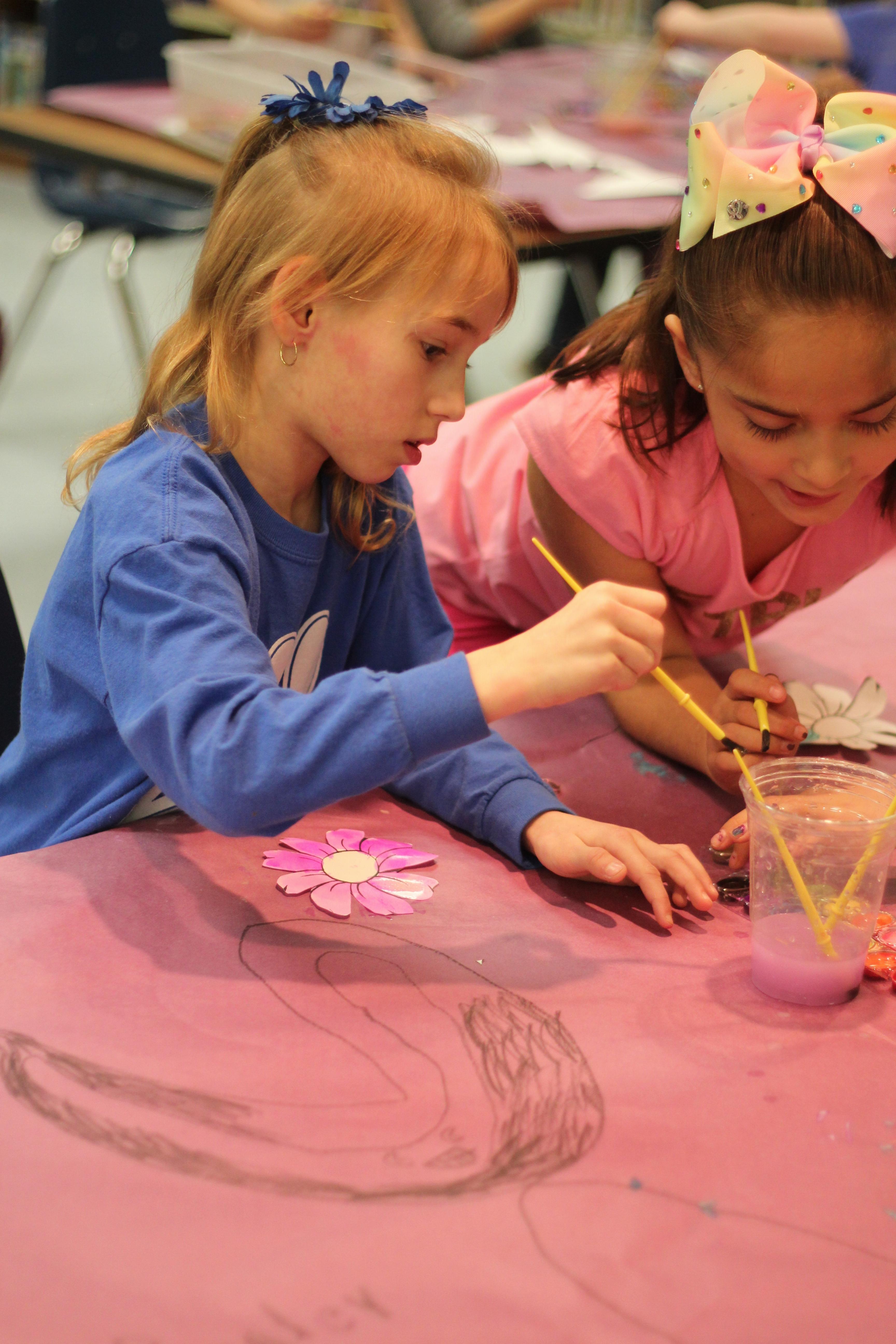 Students paint flowers.