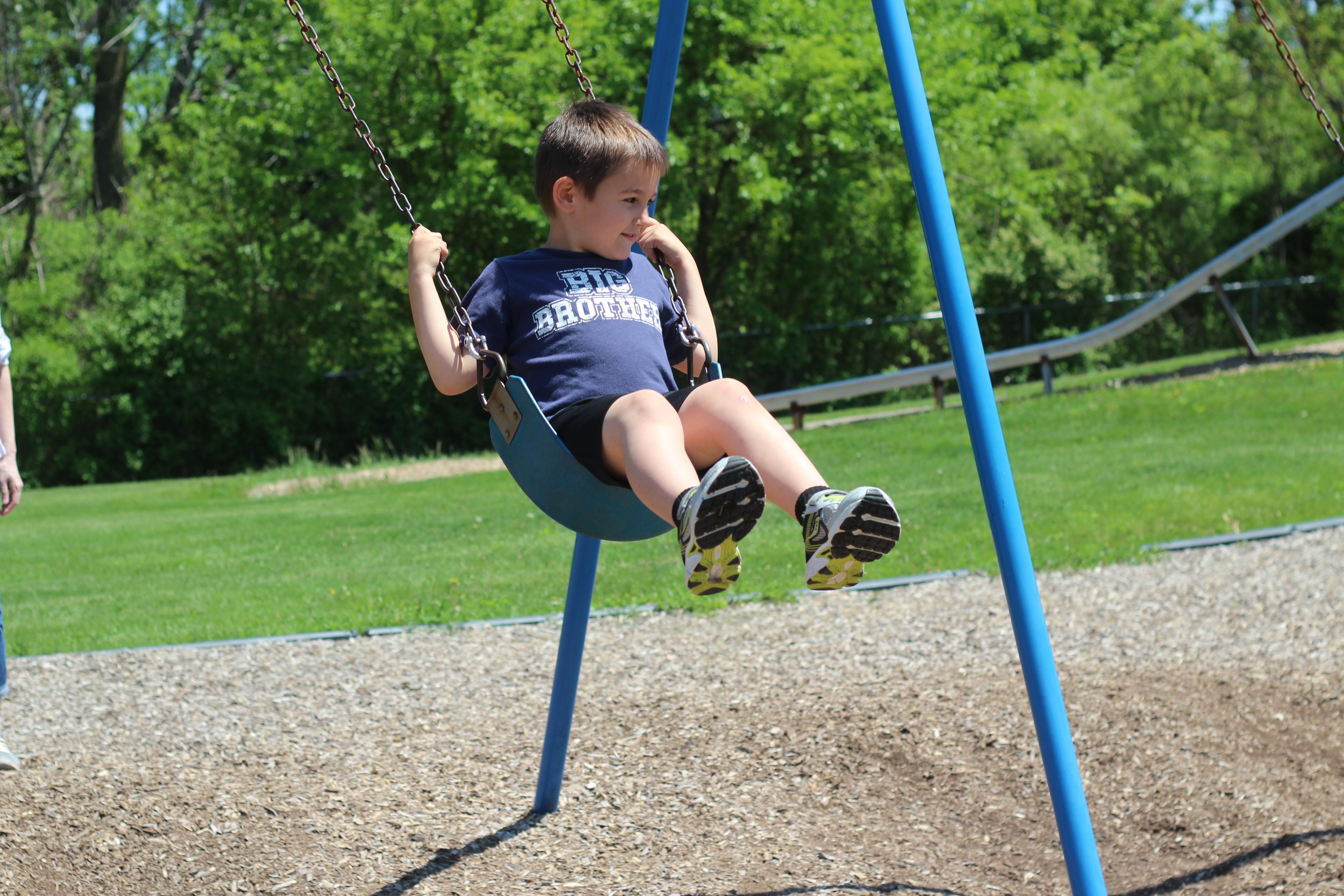 A boy is on the swing