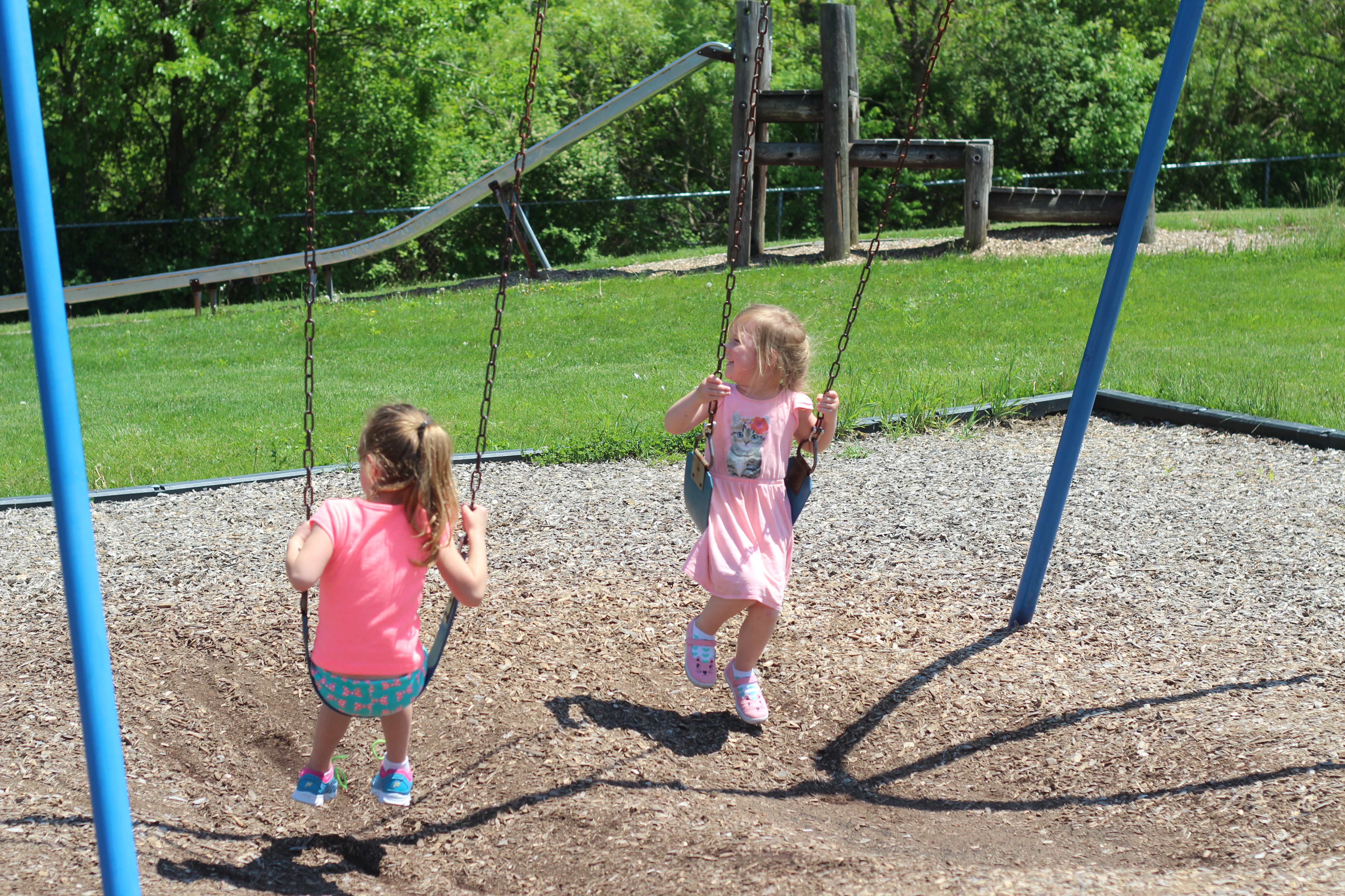 Two girls swing