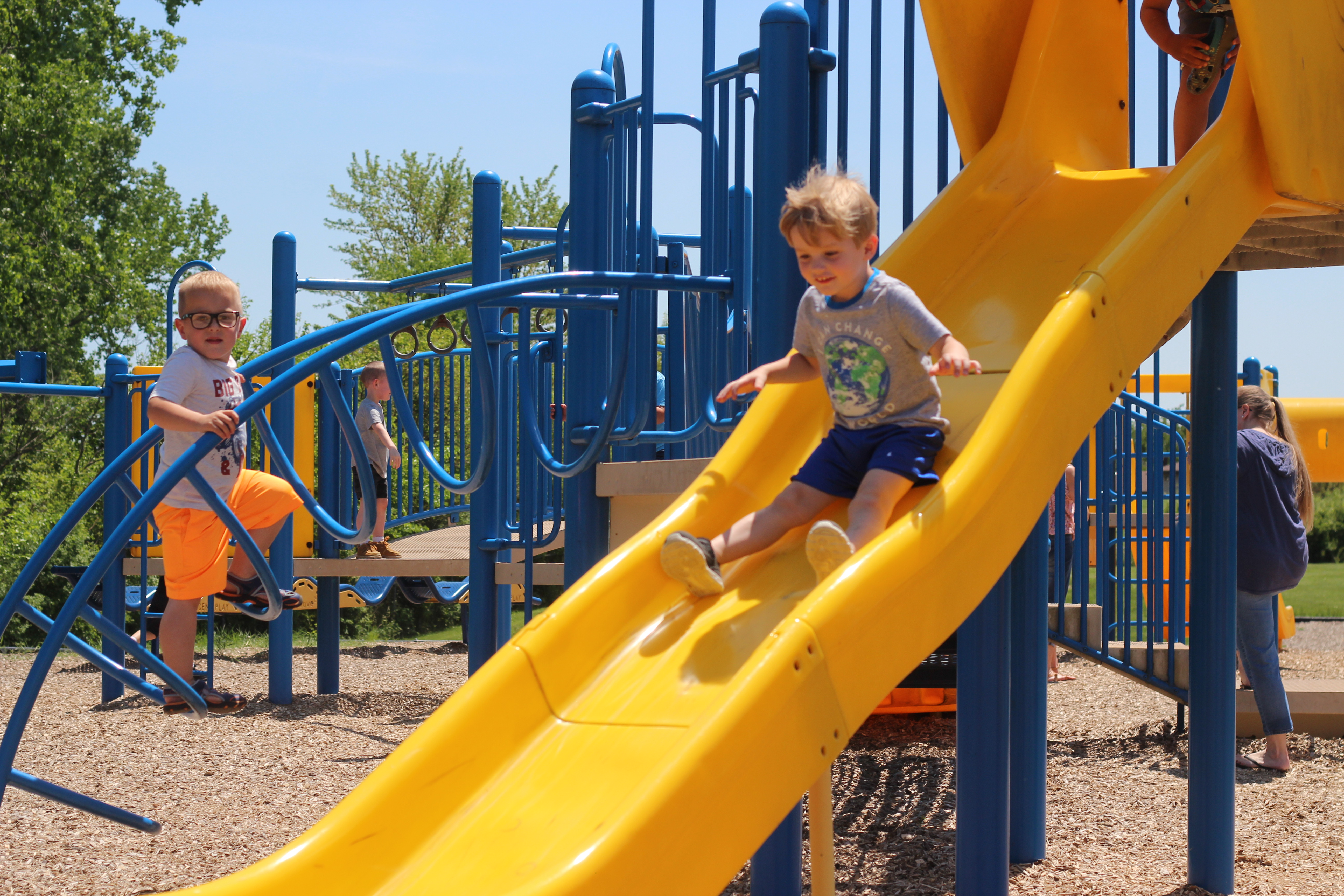 A students goes down the slide