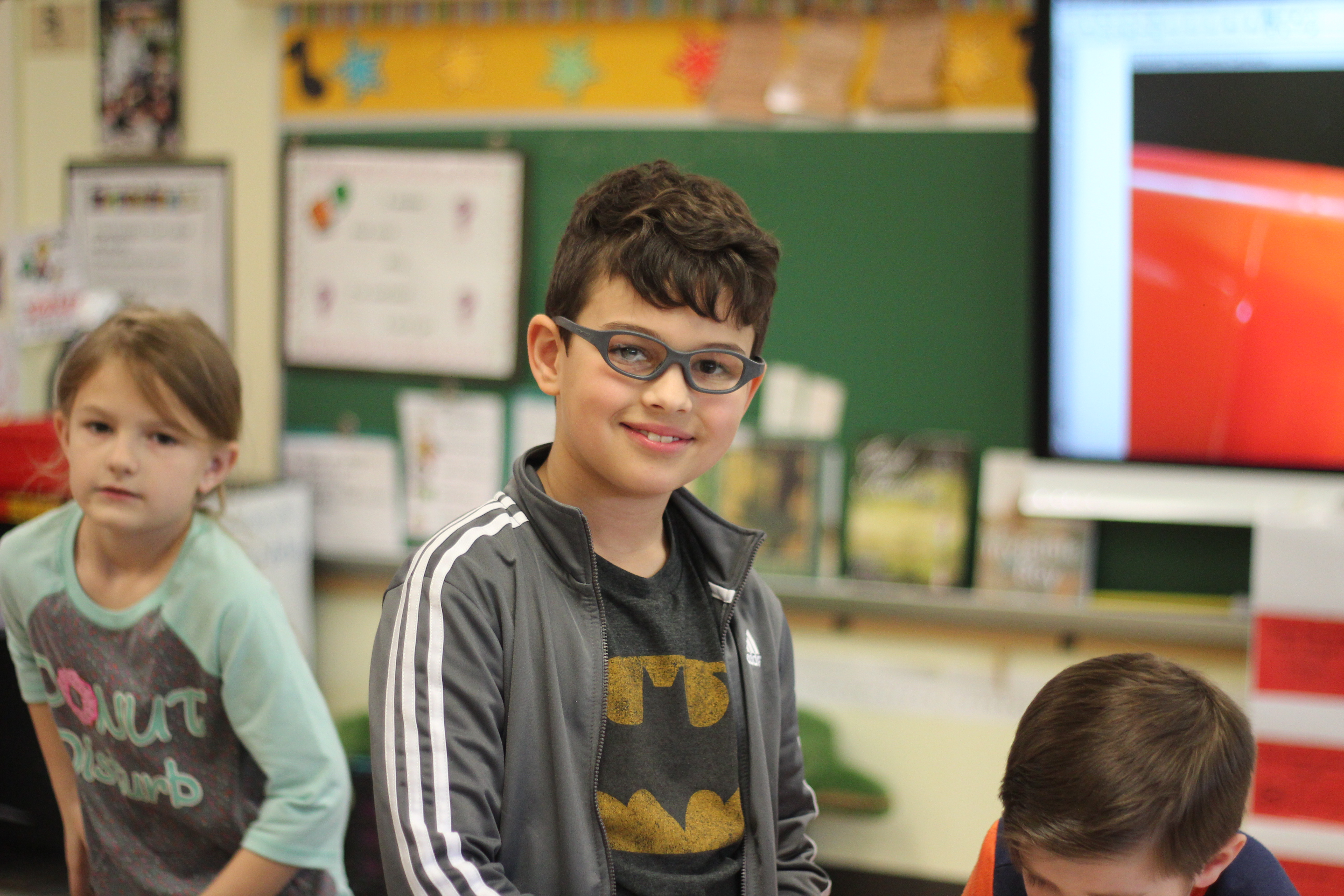 A student smiles at the camera.