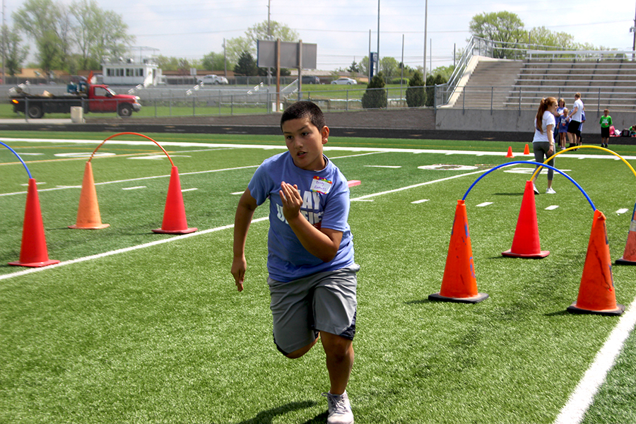 A Protsman student runs down the football field