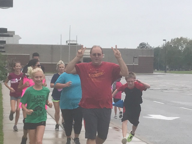 "On Friday, Sept. 7th, Clark Middle School's Boys and Girls Cross Country team ran their 3rd annual ""RUN WITH YOUR FAVORITE TEACHER"". Students invited their favorite teachers to run a one mile course together ( in the rain this year ) and enjoyed a table of treats after the run. We appreciate the support that the teachers give to the Clark Cross Country Program!!"