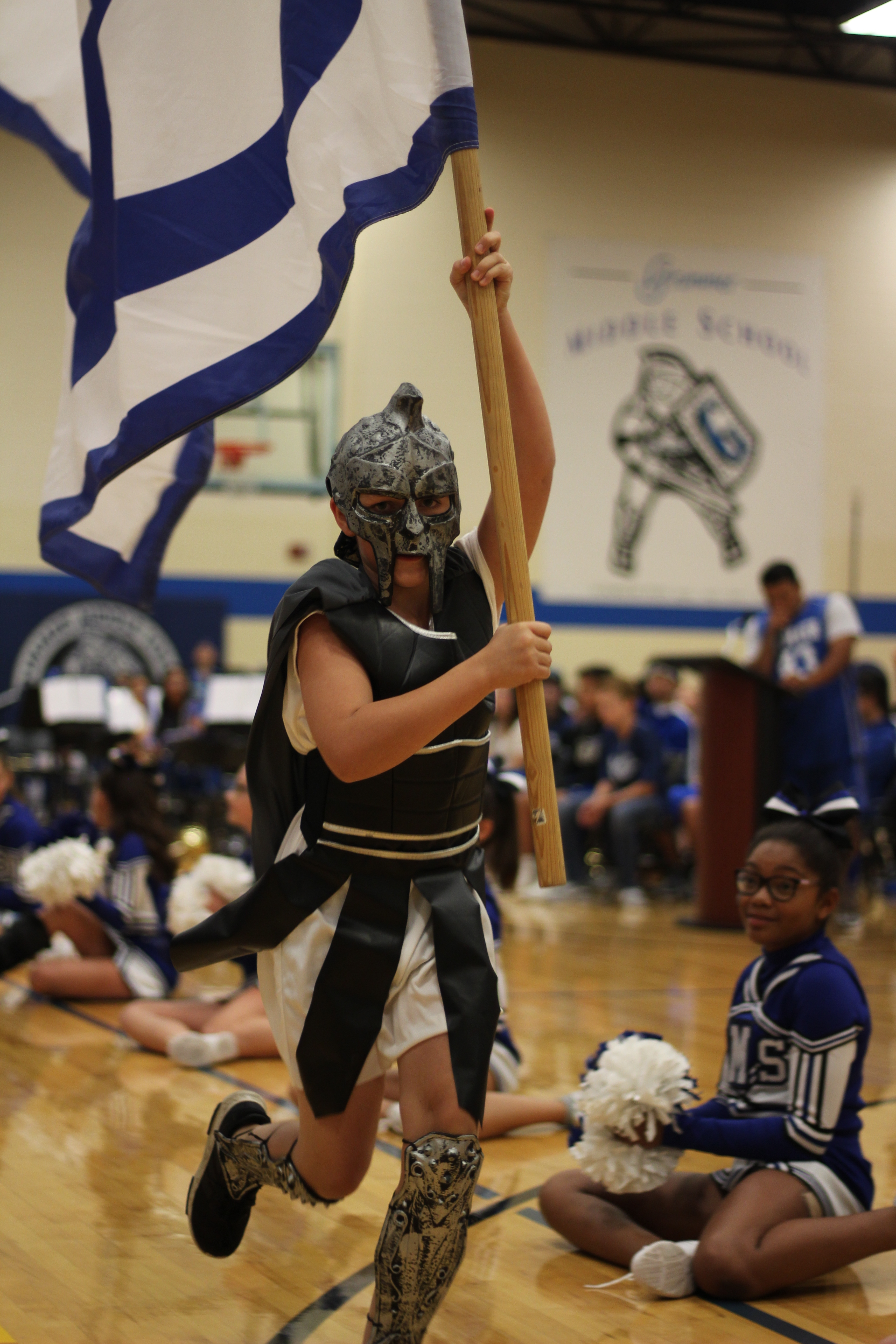 Gladiator runs across the gym