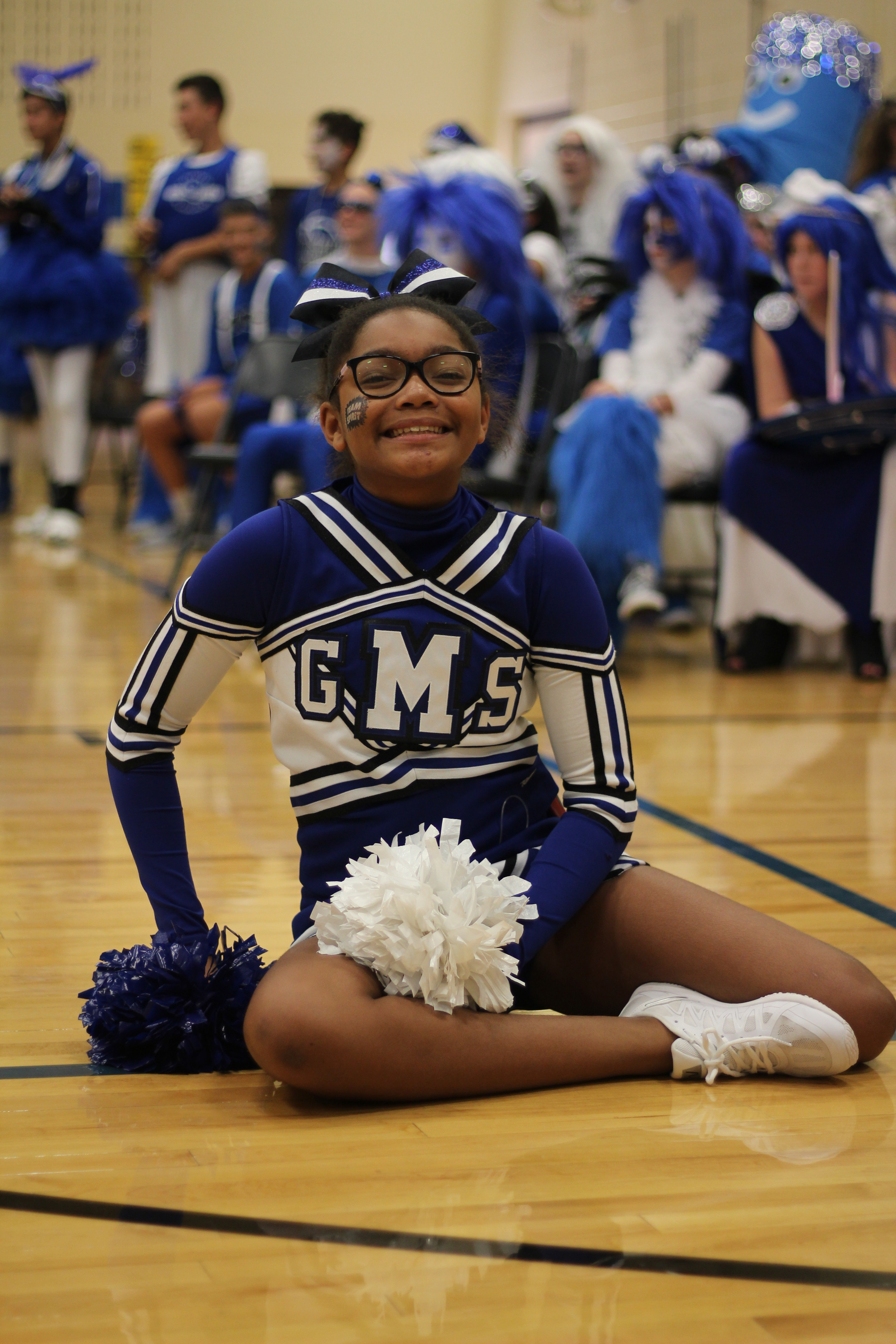 Cheerleader poses for a photo