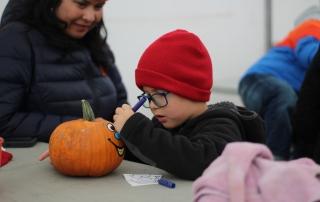 Student decorates his pumpkin