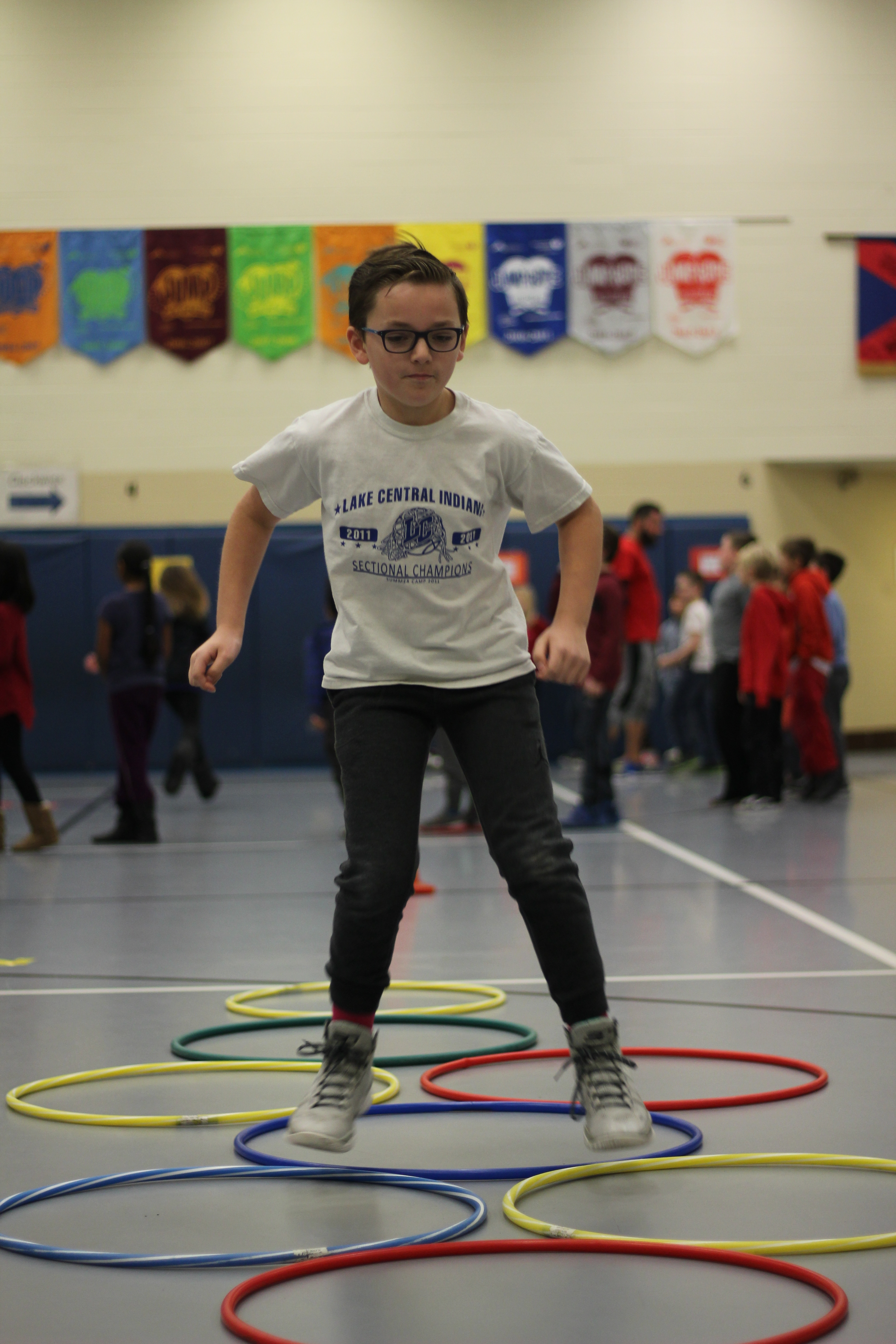 A student participates in the obstacle course