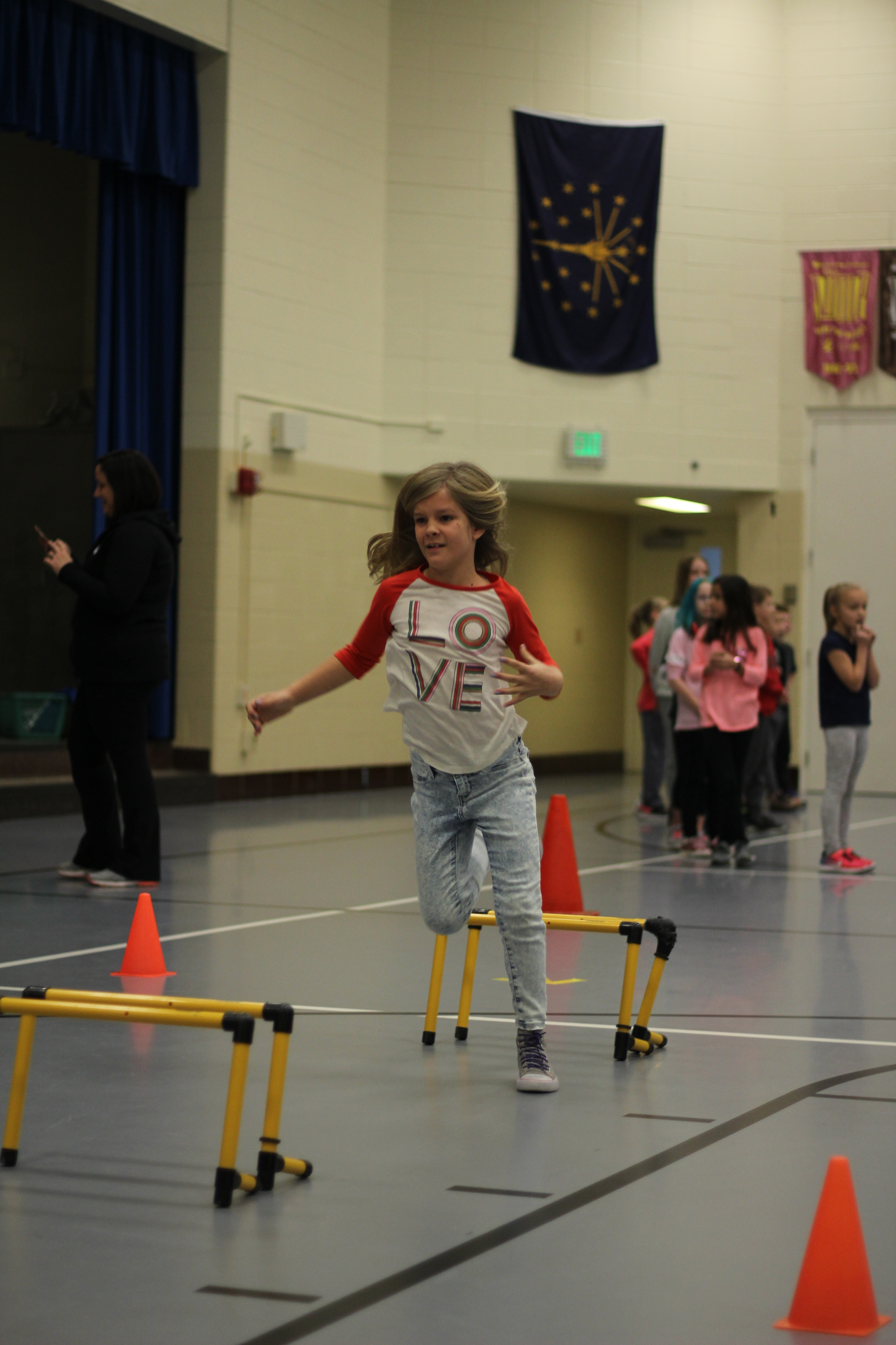 A student participates in an obstacle course