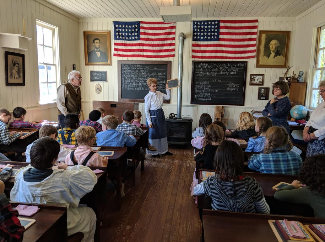 Homan 4th graders stepped back in time to experience what a typical school day for a local pioneer child would have been like in 1872. Instructing the students were former LC employees Marge Woldt and Dave Andrew and Sandi Sidock.