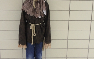 A student dresses up as a scarecrow.