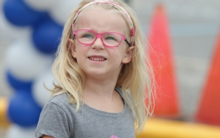 Girl smiling at the Walk-a-thon