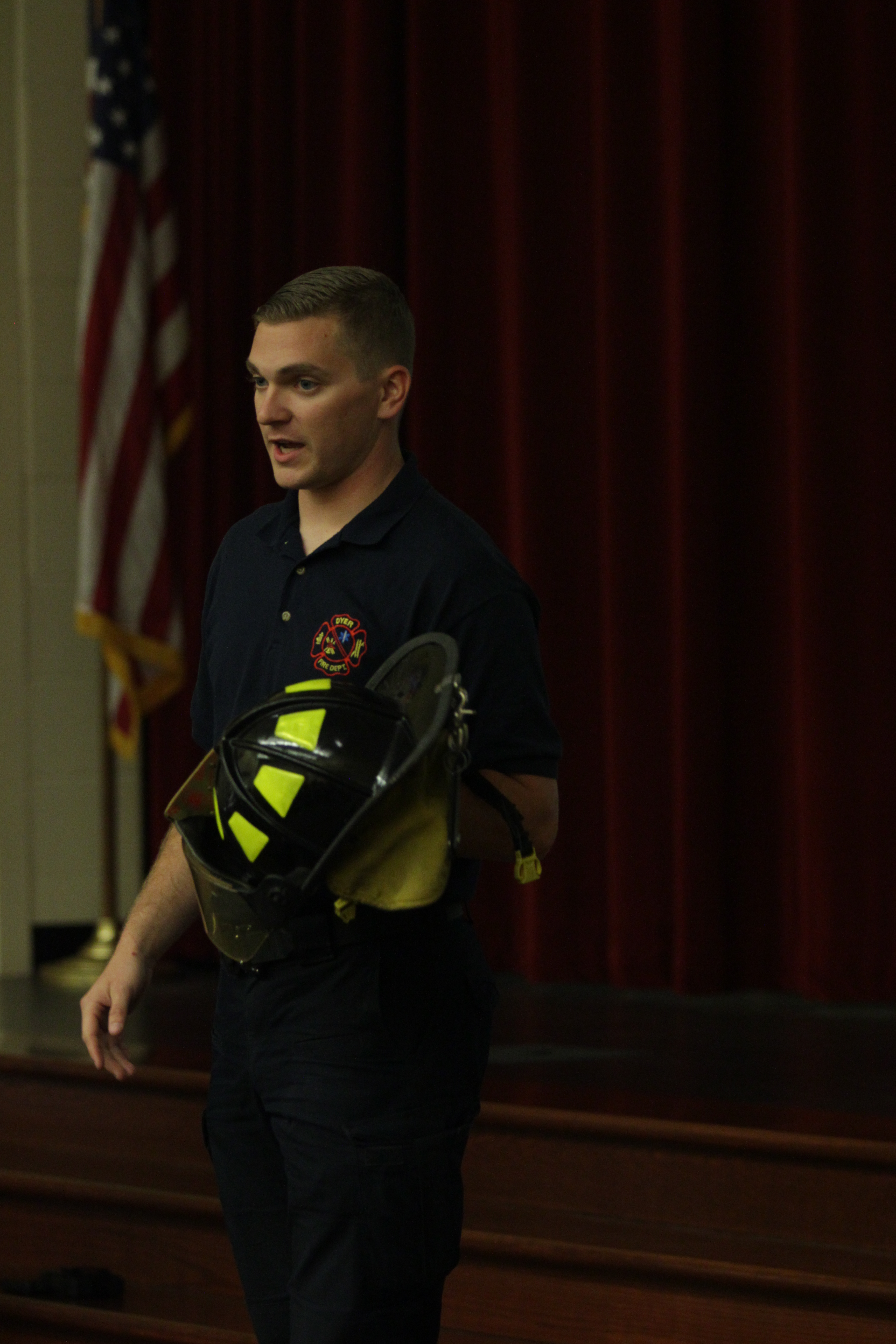 A firefighter talks to the kids