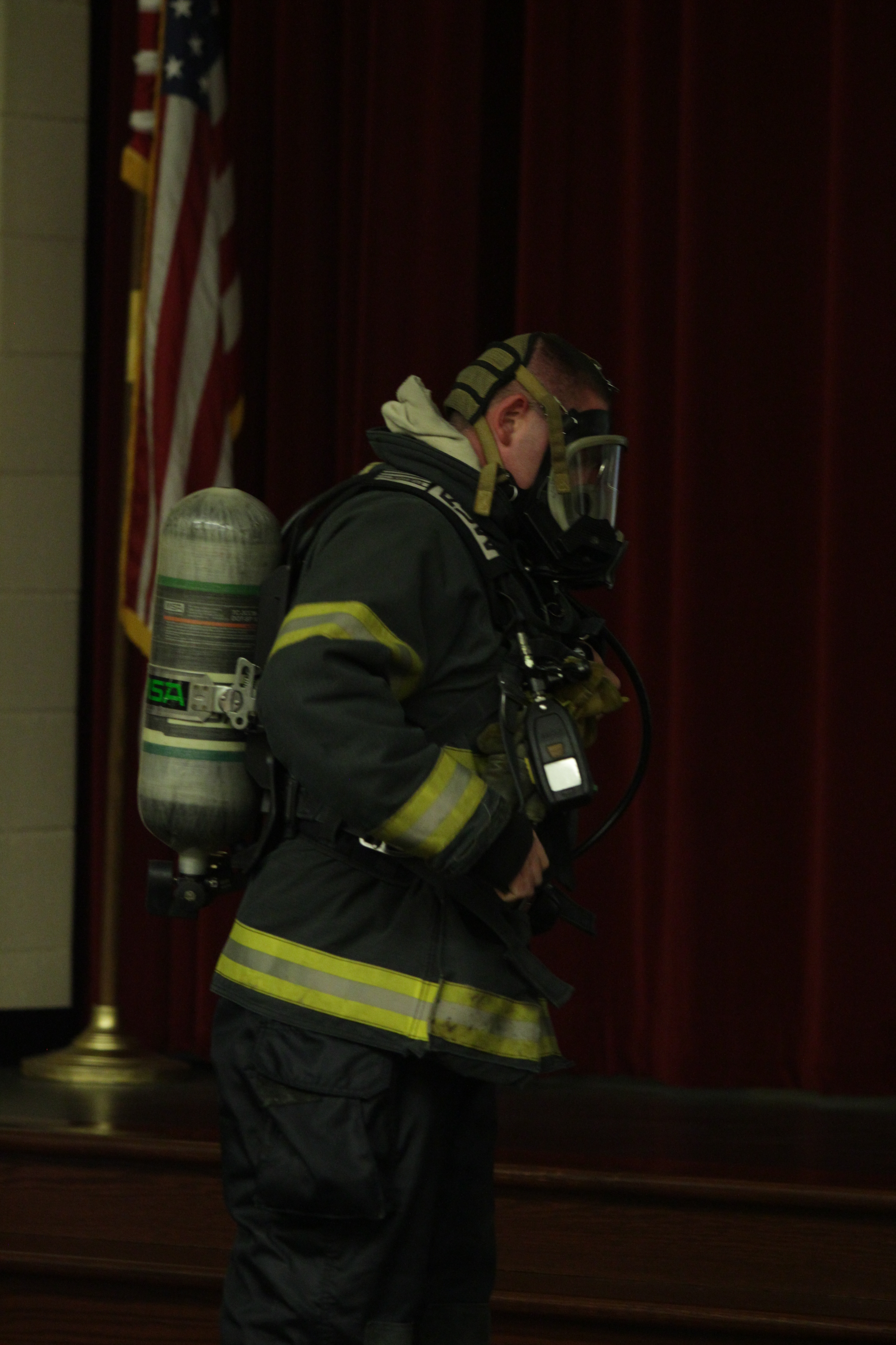 A firefighter shows his mask