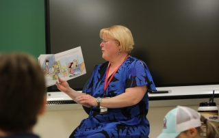 Mrs. Zollman reads a story to students
