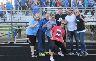 Teachers smile at the pep rally.