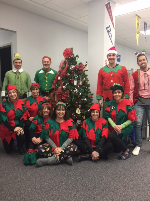 Clark Staff gets into the holiday spirit by dressing up as elves!