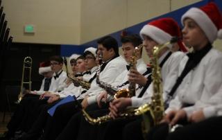 Students watch their peers perform
