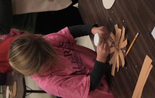 girl helping glue