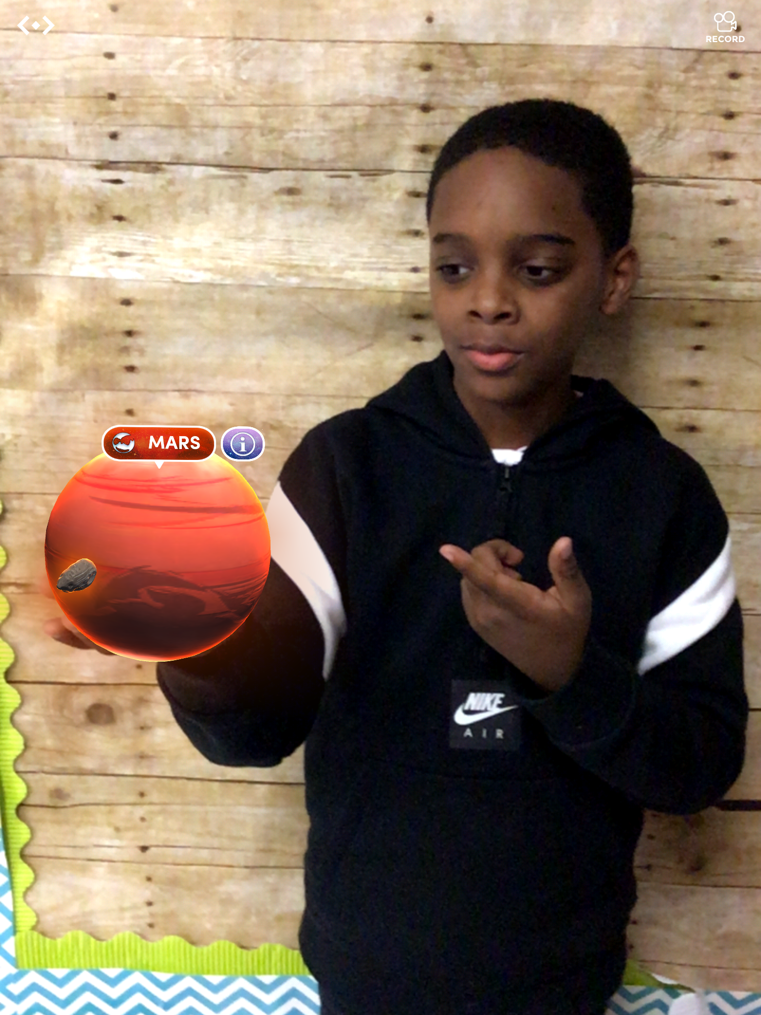 Devin Threets held Mars in the palm of his hand during a recent science lesson in Ms. Bridgeman's 5th grade science class at Clark Middle School.