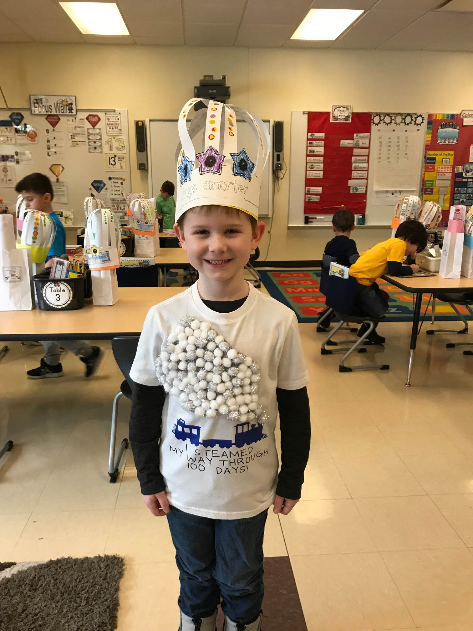 Protsman Elementary Kindergartner Quinlan Denihan a student in Ms. White's class, happily celebrated the 100th Day of school with his classmates.