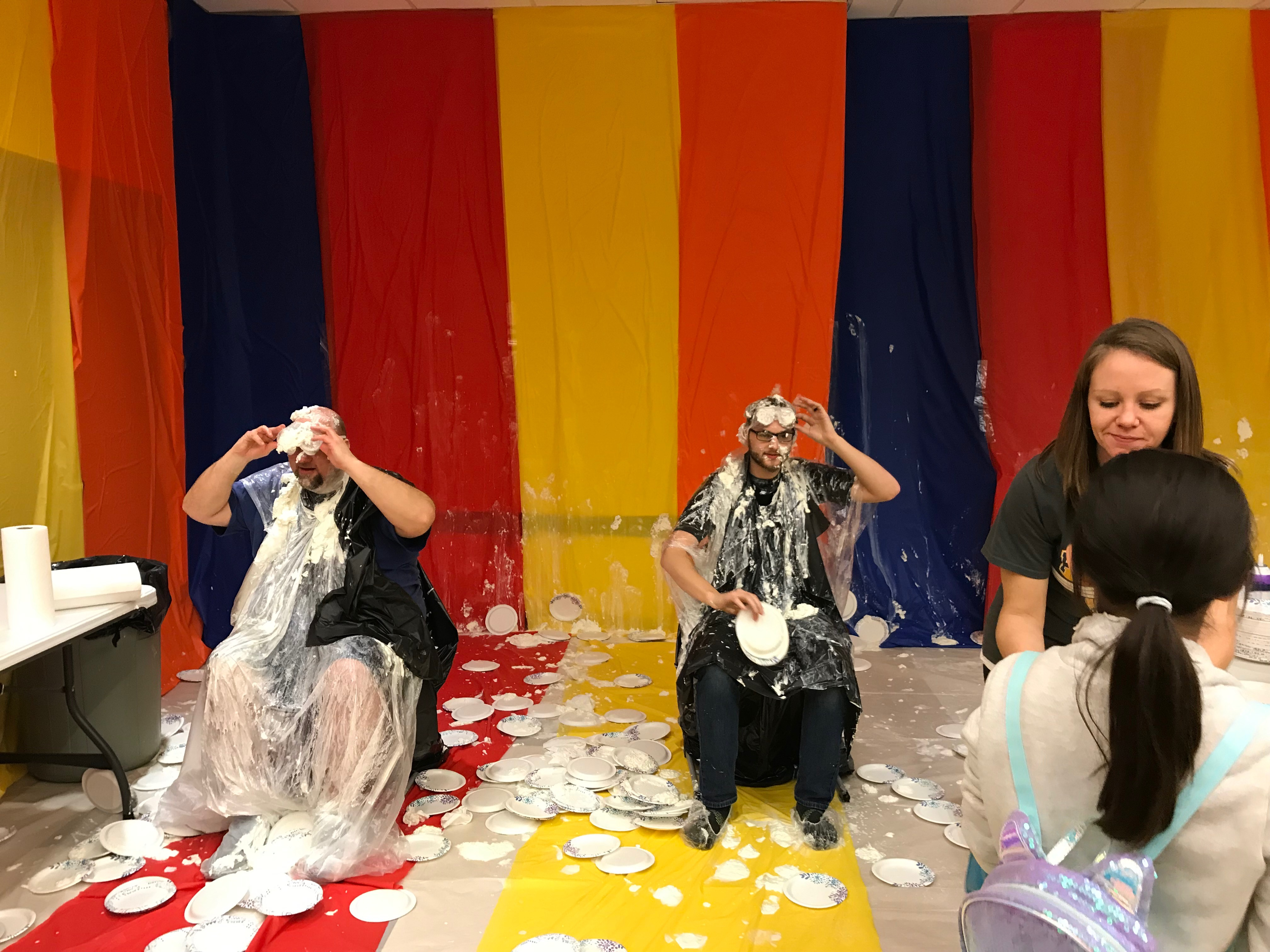Brave staff members Mr. Karin, Mr. Michniewicz and Mrs. Cashen during the Fun Fair at Protsman Friday evening. They were great sports as they took pies to the face for charity!