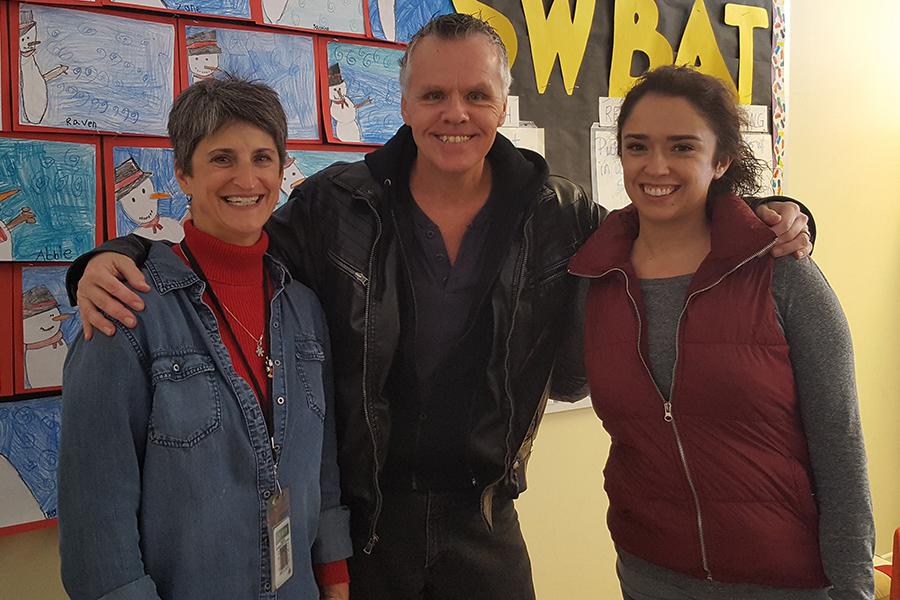 Mrs. Zolfo, Mr. Davich and Mrs. Zolfo's daughter all smile.