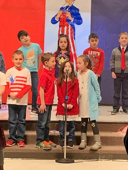 Salute to America by Mrs. Radencic's 1st grade class at Watson.