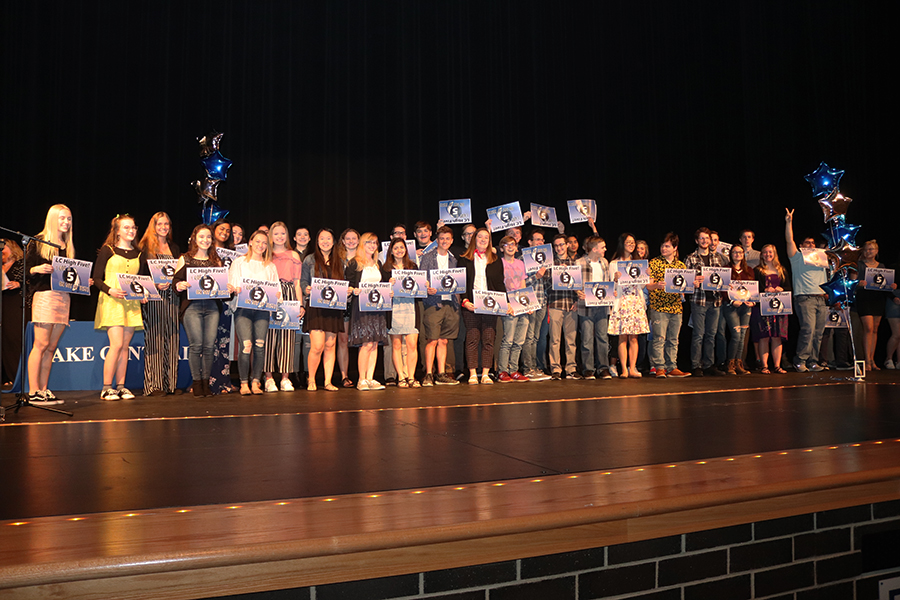 "LC Seniors proudly display their ""5"" placards which signify their attainment of a 5 on at least one AP test during their Freshmen through Junior years!"