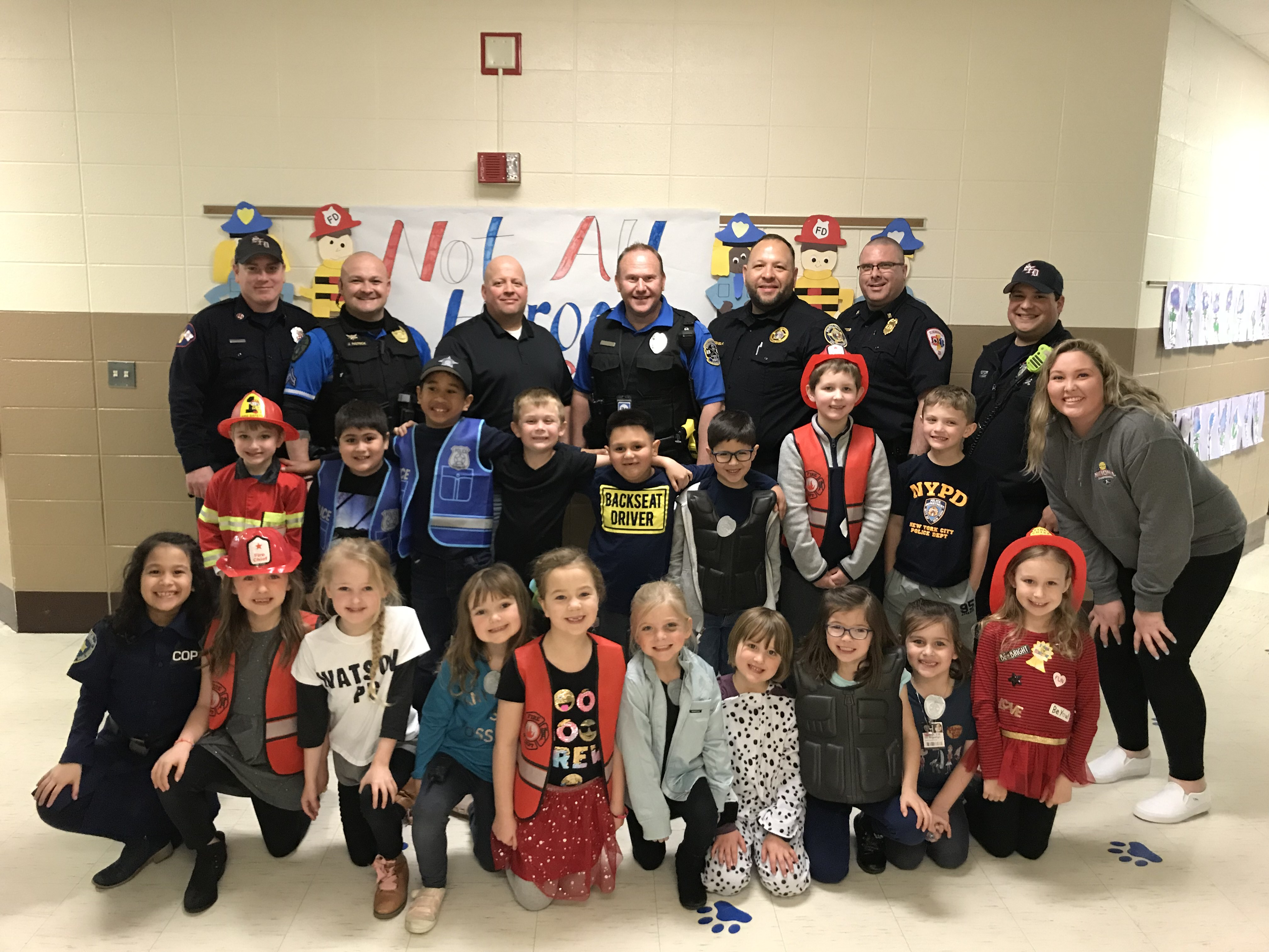 Watson kindergarten celebrates Hero Day with local police and firefighters.