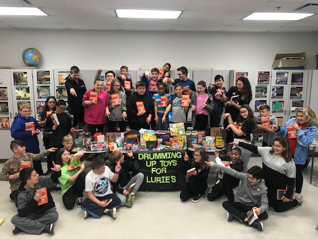 Sixth grade students at Clark Middle School just finished reading the novel Drums, Girls, and Dangerous Pie by Jordan Sonnenblick. As an extension activity to the novel, the students participated in a toy drive for Lurie Children's Hospital in Chicago. The students were able to collect over 150 items for the children of Lurie's!