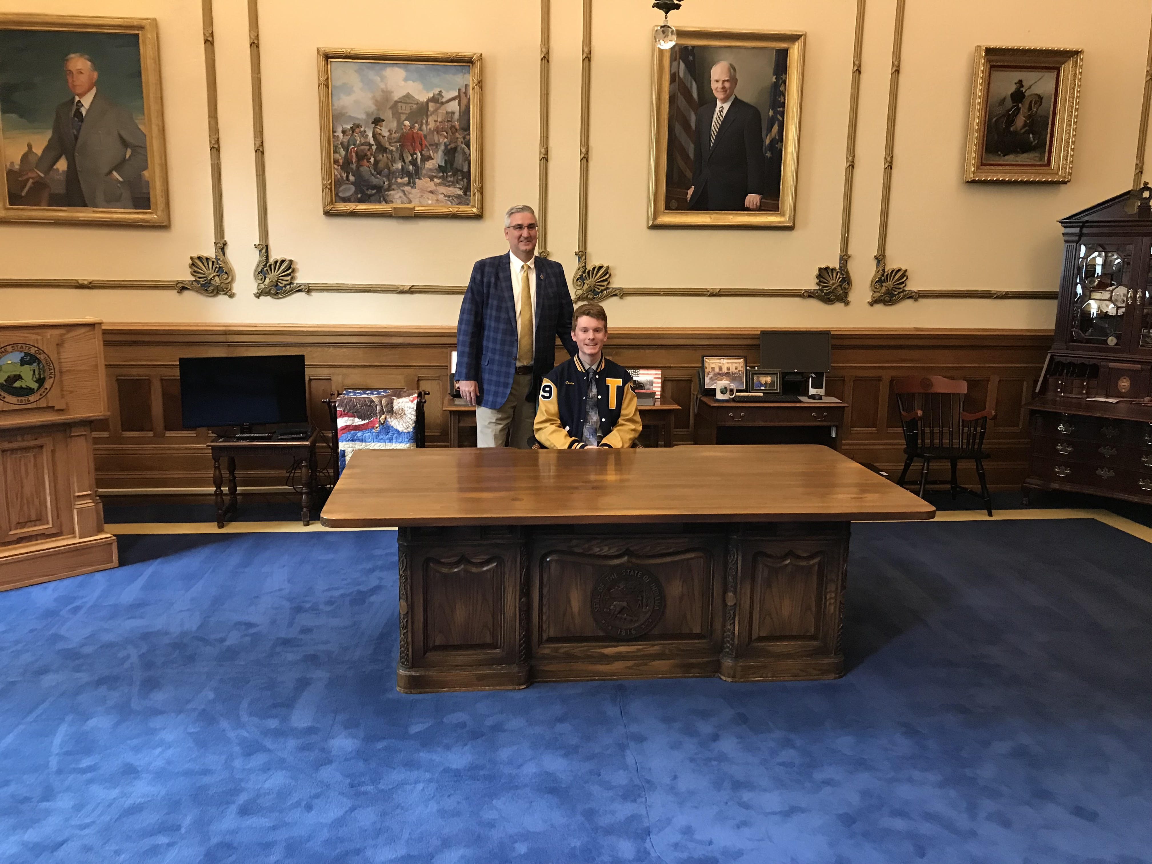 After being selected to Governor Holcomb's prestigious STEM team , Carter Goldman tries on the Governor's chair for size.