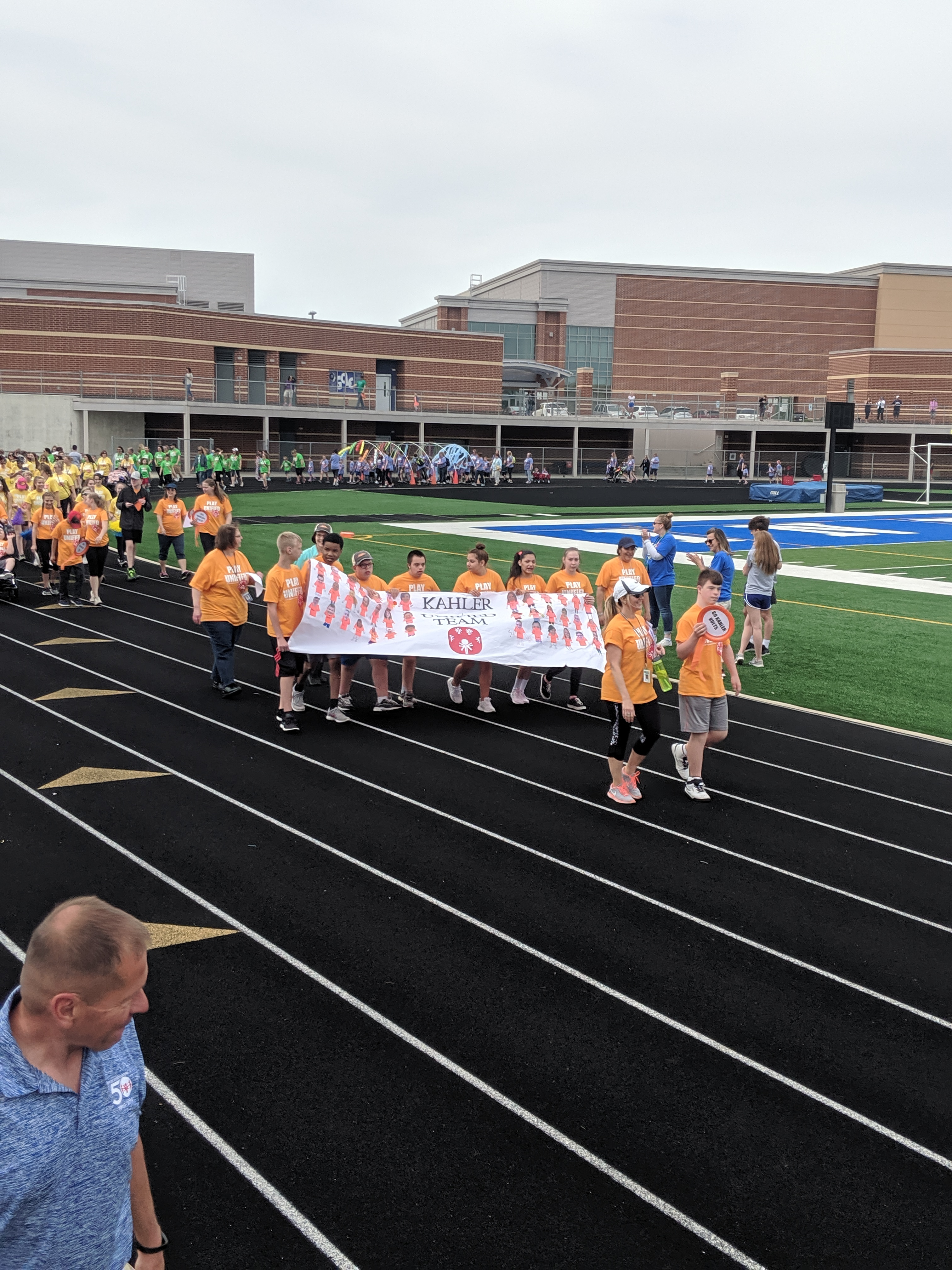 Student athletes parade around the track prior to the beginning of Lake Central's Second Annual Unified Game Day!
