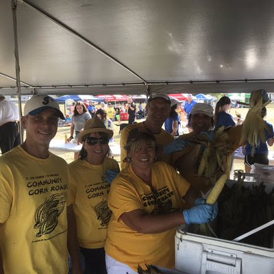 Members of Clark staff working at the annual St. John Chamber/Tri-Town Rotary Corn Roast.