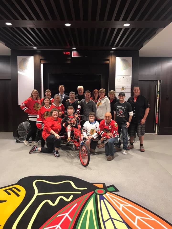 Grimmer student Nick Burton received an adaptive bike from Johnathon Toews at the game last night in Chicago!