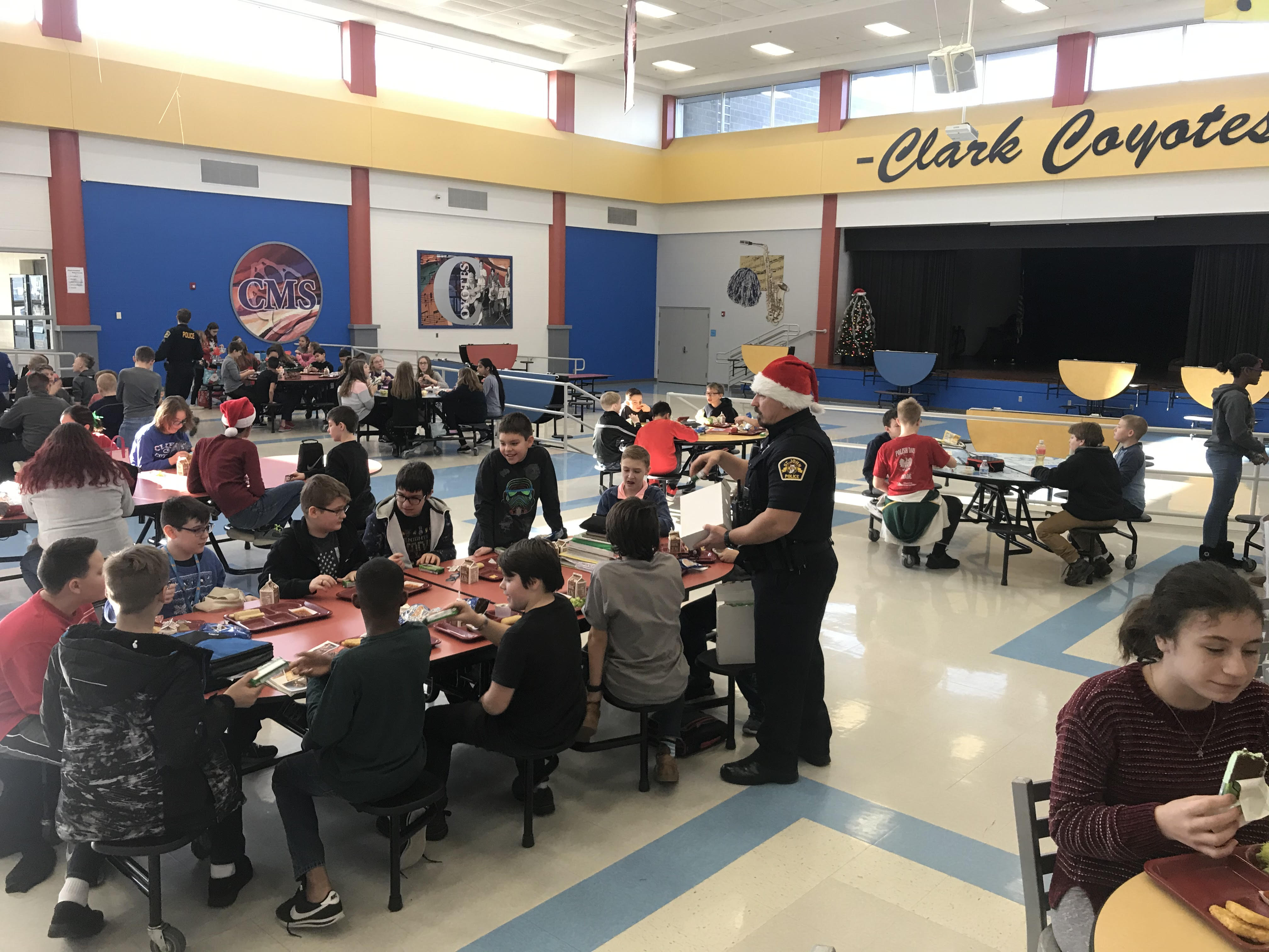 SRO Nick Stamate passing out ice cream to students during lunch. Happy holidays!