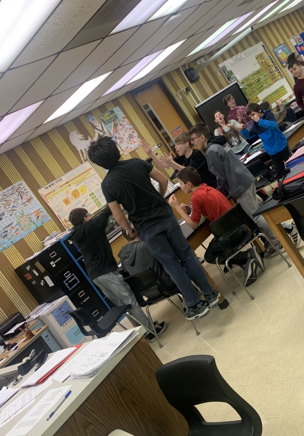 Students in Mr. Meyer's Advisory class celebrate after hearing they were class winners in the Superbowl Trivia contest at Grimmer MS.