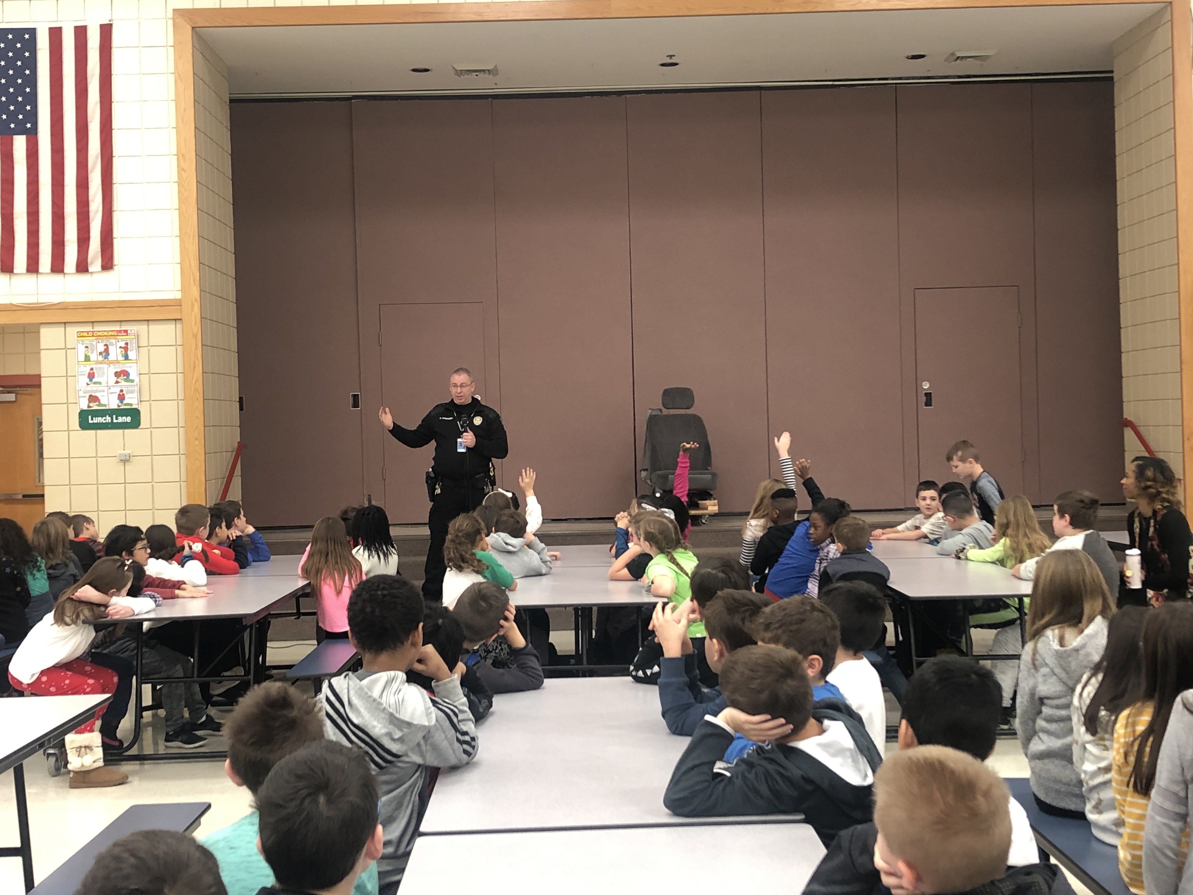 School Resource Officer Brian Kissinger teaches 3rd Grade Peifer students about Booster Seat safety.