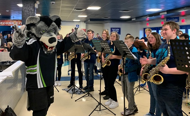 The Kahler Middle School Jazz Band prepares to be directed by the team mascot prior to performing at the Chicago Wolves hockey game on Sunday, February 16, 2020.