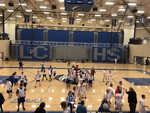 The Lake Central Varsity Cheer Team congratulates member of the Lake Central All Stars and Crown Point Bulldogs after their game on Thursday February 20, 2020.