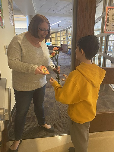 As part of their fundraiser for Special Olympics Indiana, Protsman students deliver flowers to staff!