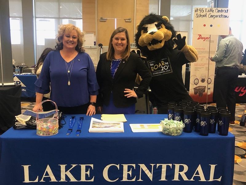Lake Central High School administrators Kari Regan and Erin Novak solicit the help of the Purdue Northwest mascot Leo the Lion at their recent job fair.