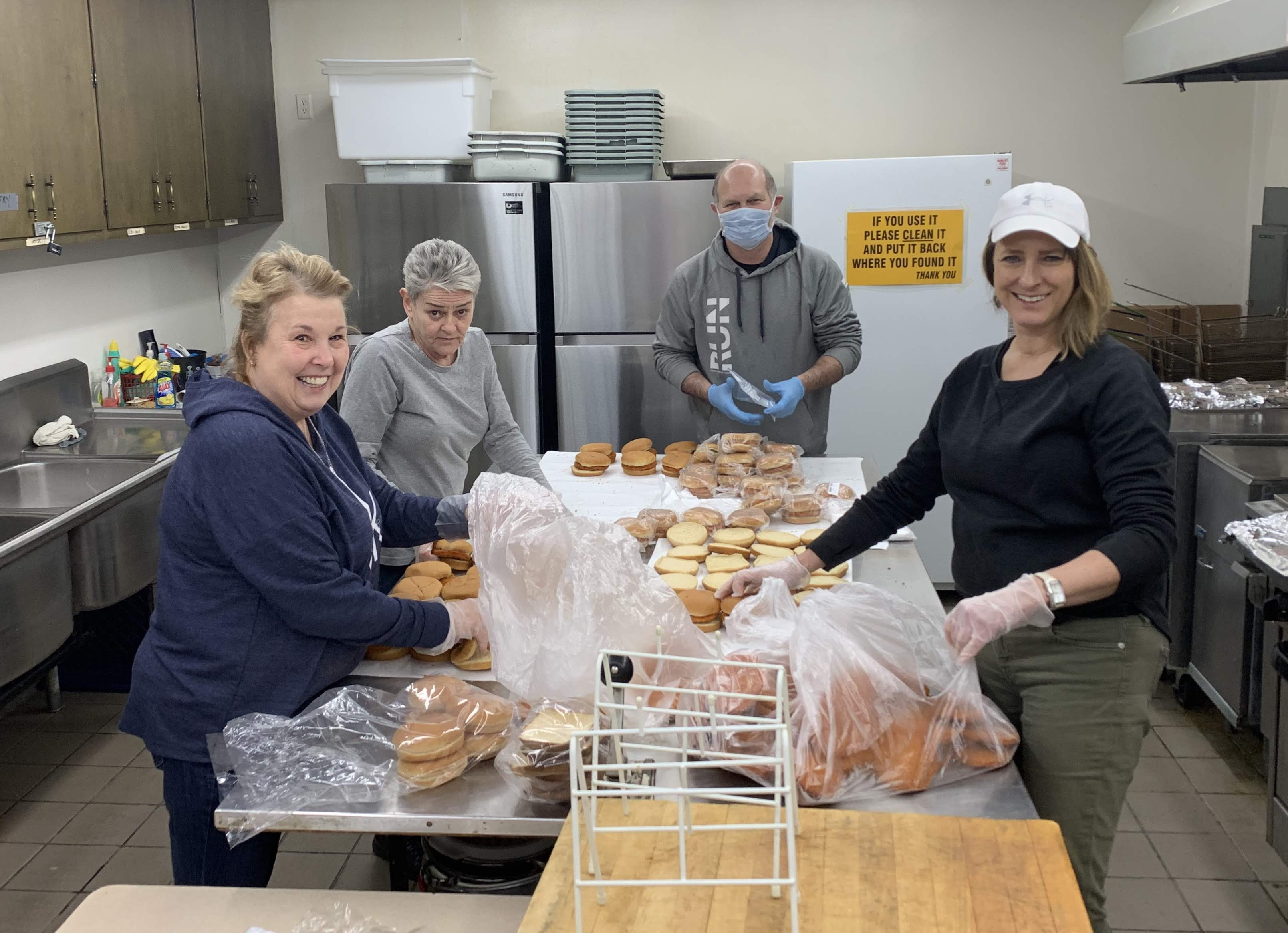 LC Food Service staff members Debbie Caldwell, Ricky Zarowny and DeAnn Alleva along with Mr. Graber, pack lunches at the VFW.