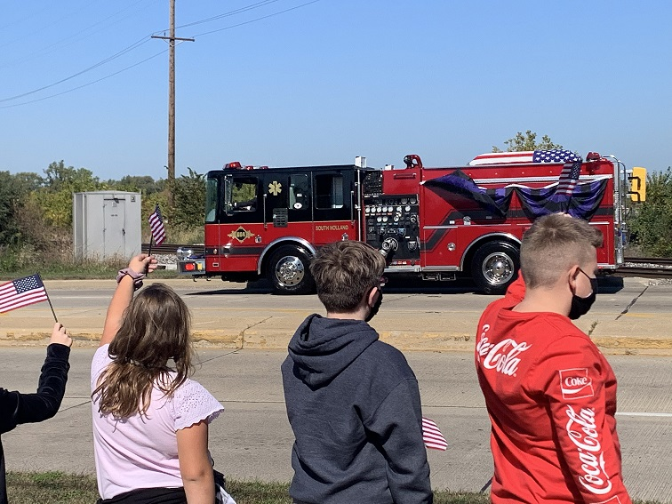 Our 5th grade teachers and students lined route 30 with American flags for the procession for the fallen S. Holland firefighter/EMT. It was sad and solemn. The kids represented L.C. admirably.
