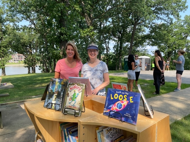 Renee Wells and Michelle Fertig helping students pick out books at the Uni in Lake Hills.