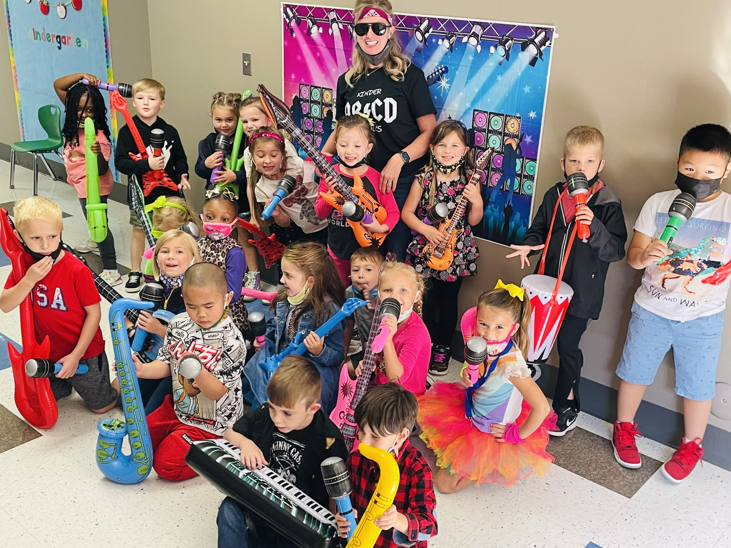 Kolling students complete 844 acts of kindness and raise over $23,000 throughout their community. Classes celebrate by Rocking out!